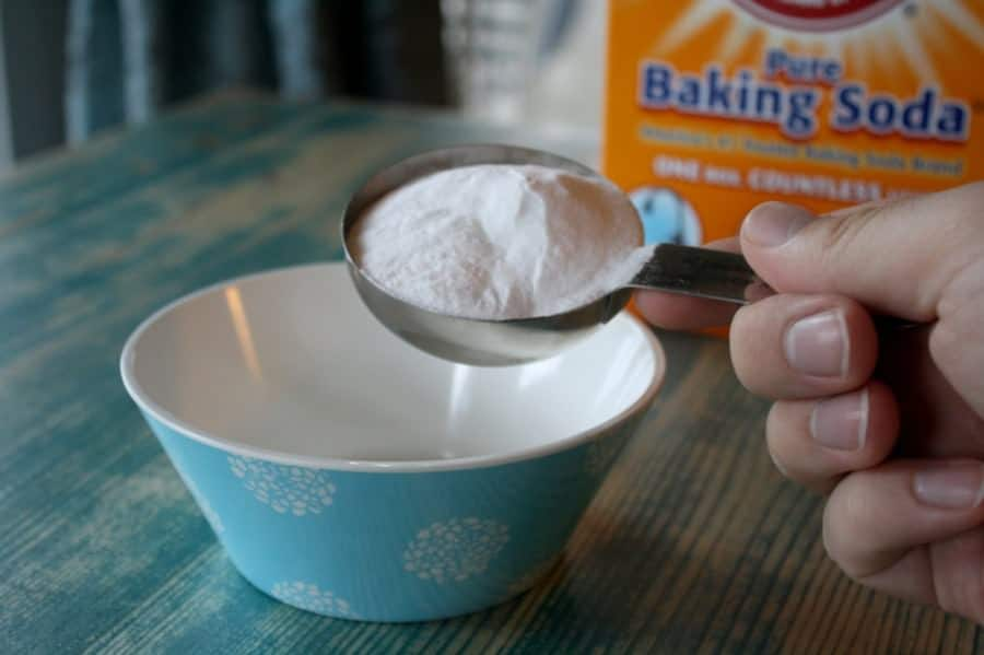 Adding baking soda to your carpets and rubbing them thoroughly before you vacuum